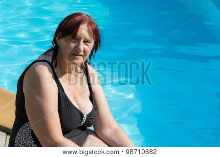 Senior Active Woman By A Swimming Pool