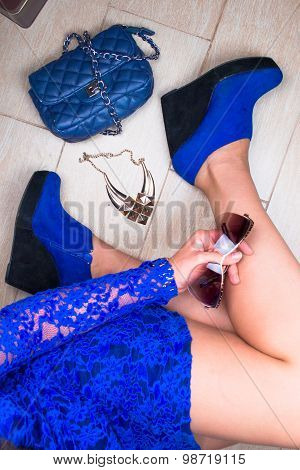 Stylish woman legs. Blue outfit. Top view
