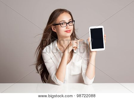 Brunette Woman Using Tablet Computer.