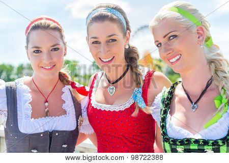 Women friends visiting Bavarian fair in national costume or Dirndl