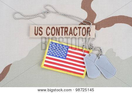 Kiev, Ukraine - June 14, 2015. Us Contractor Branch Tape With Dog Tags  And Flag Patch On Desert Cam