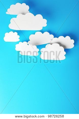 White paper clouds on blue background. Cloud computing concept.
