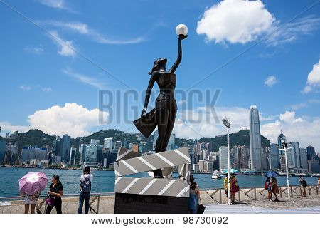 Bronze Statue Of Hong Kong Film Awards And Skyline
