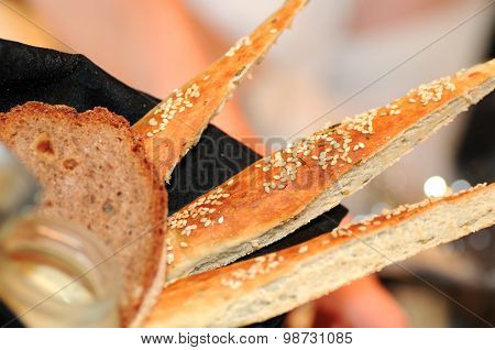 different types of bread: triangle bread sticks with rye bread in a basket