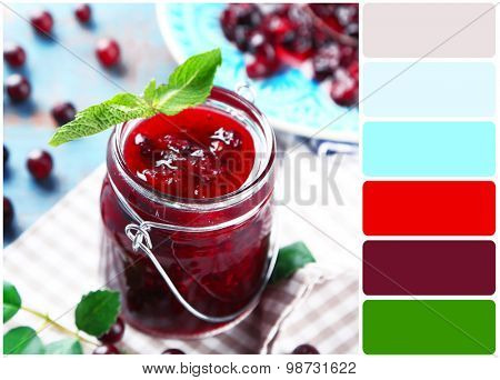 Jar of gooseberry jam on wooden table and palette of colors