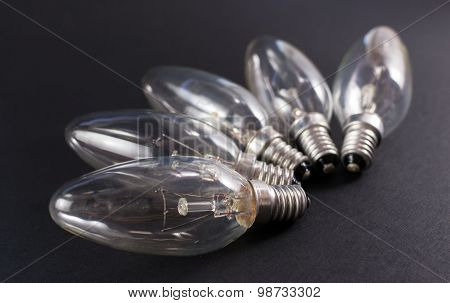 Five Broken Lightbulbs On Black Background