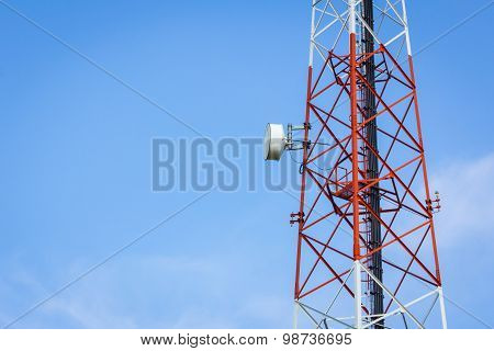 Closeup Telecommunication Tower And Cloudy Blue Sky With Copyspace On The Left