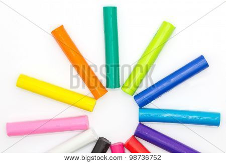 Art modelling clay sticks on white background