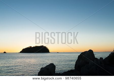 Stunning Sky At Sunrise Silhouette Rocky Coast And Off-shore Island