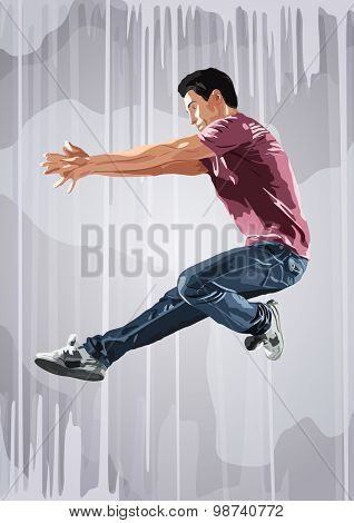 Young man dancer jumping. On wall background.