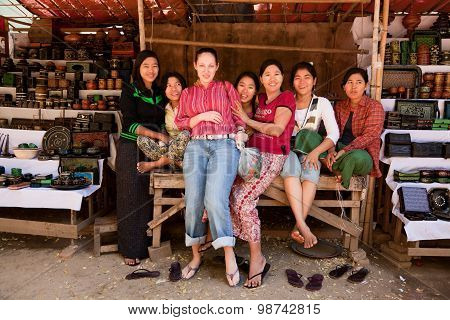 Young Tourist Woman With Local Girls In Bagan Market