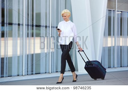 Business Woman Traveling With Suitcase And Mobile Phone