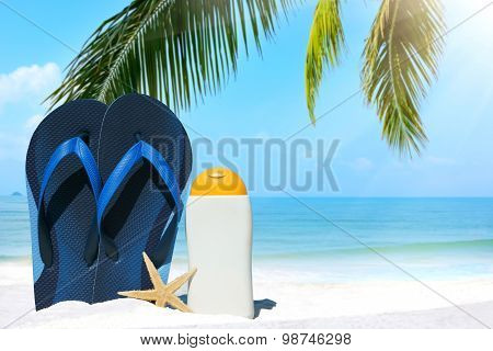 Blue Flip Flops And Suntan Lotion