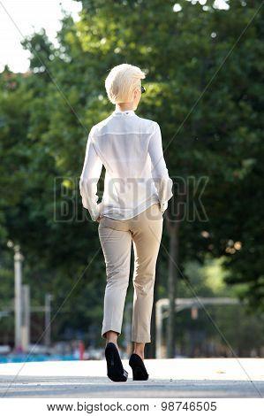 Slim Young Woman Walking Away Outside