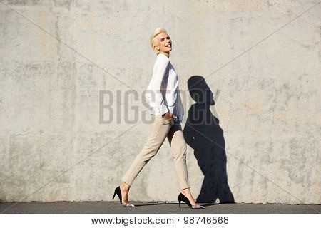 Smiling Female Fashion Model Walking