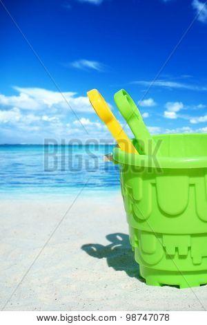 Green Plastic Bucket On The Beach