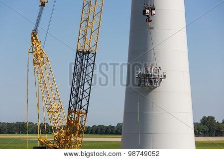 Dutch Workers Busy With The Constuction Of A New Windturbine