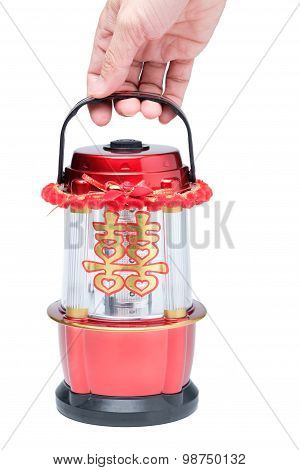 Hand Holding Chinese Led Lantern Lamp With Chinese Double Happiness Symbol