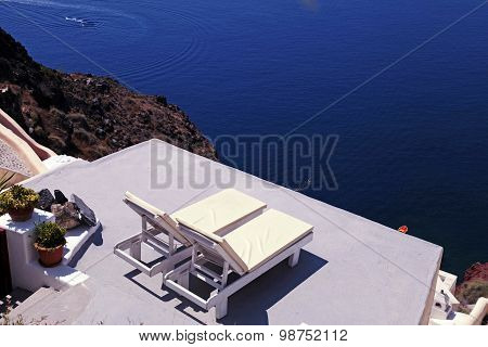 Sunbeds On The Terrace And Sea On Santorini Island, Greece.