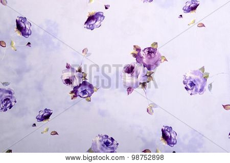 Floral Pattern On Purple Fabric.