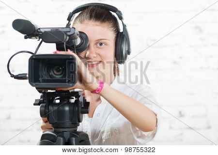 Pretty Young Woman With A Professional Camera