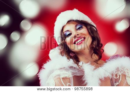 beautiful woman against colorful red background, Christmas topic