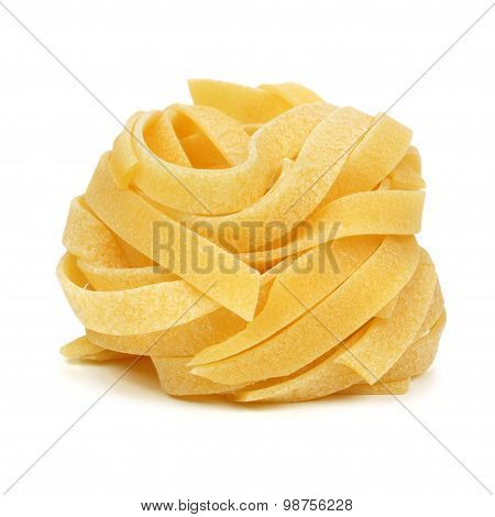 Tagliatelle pasta nest isolated on white