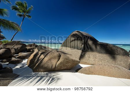 Beautifully Shaped Granite Boulders And A Perfect White Sand
