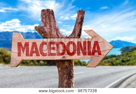 Macedonia wooden sign with road background