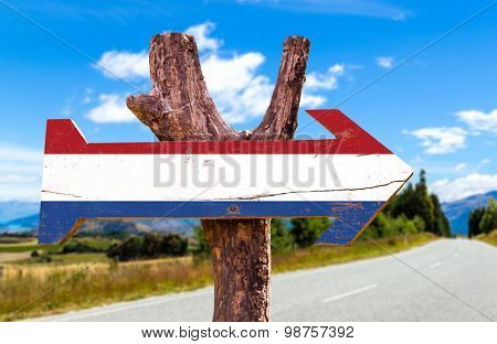 Netherlands Flag wooden sign with road background
