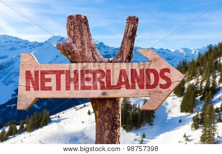 Netherlands wooden sign with winter background