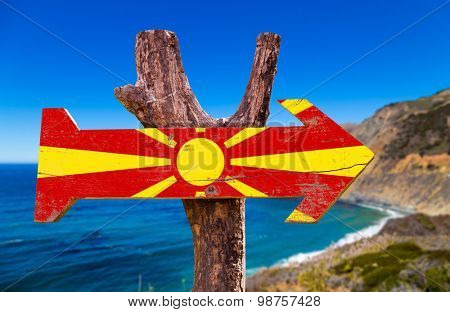 Macedonia Flag wooden sign with coast background