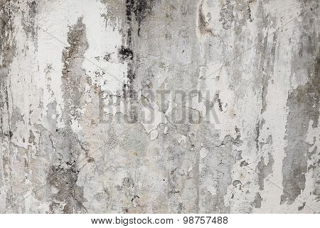 Old painted wall. The paint is peeling off