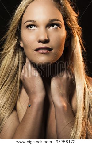 Cinematic style studio portrait of a woman