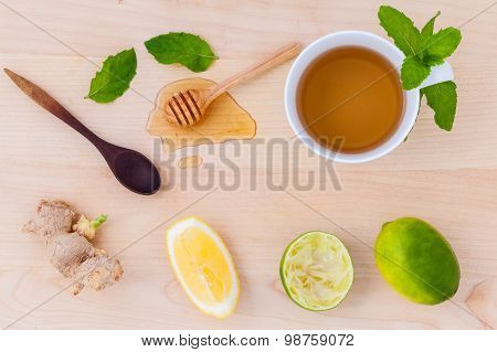Cups Of Herbal  Tea With Aromatic Herbal With Lemon , Lime And Honey .