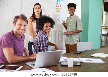 Portrait Of Businesspeople Having Creative Meeting In Office