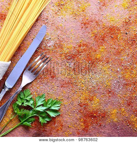 Seasonal table setting with pasta and cutlery.