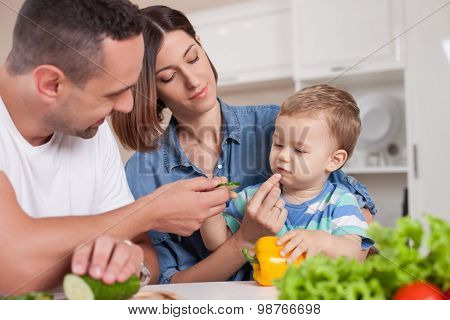 Cheerful friendly family is eating in kitchen