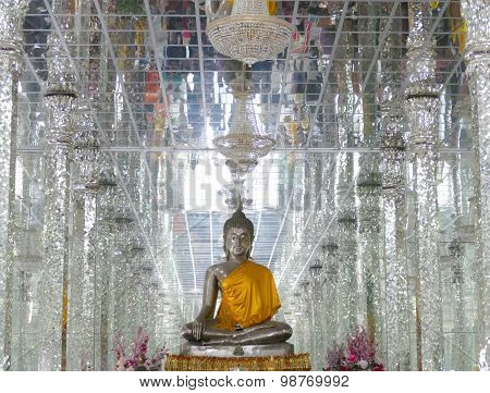 Reflection Of People On The Ceiling In Buddhism Temple With Buddha Statue