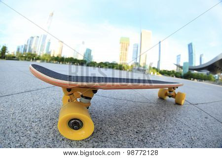 closeup of skateboard on city shot on fisheye