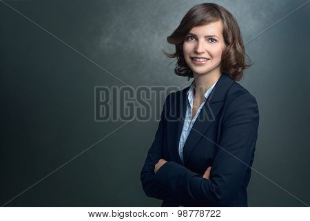 Happy Young Businesswoman Smiling At The Camera