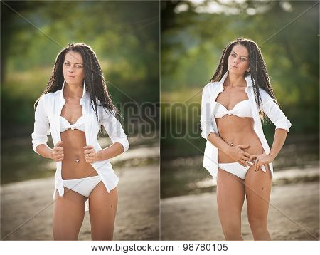 Portrait of young sexy brunette girl in white swimsuit and male shirt posing on a beach