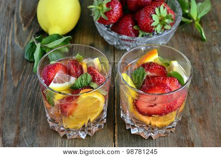 Drink with strawberries and citrus