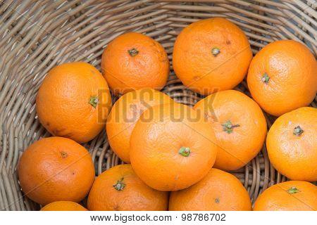Oranges in basket close-up.
