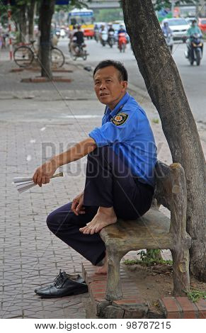 security officer is resting on the bench