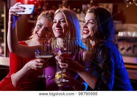Girls Taking Selfie At Bar