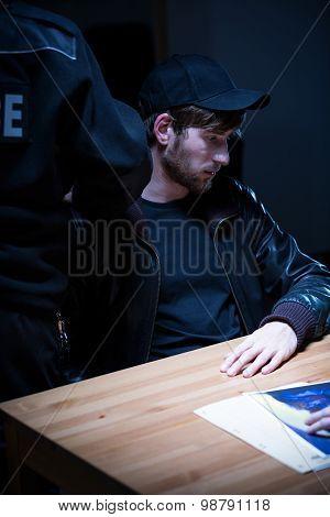 Policeman Nailing A Criminal