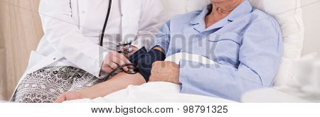 Man Having Measured Blood Pressure