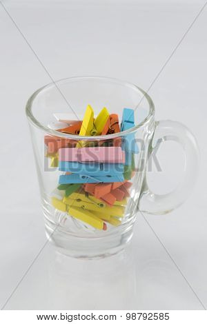 Color wooden clips in glass.