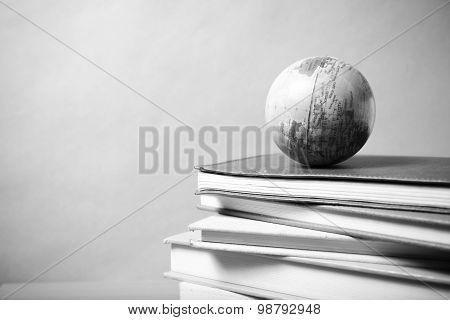 Stack Of Book And Earth Ball Black And White Tone Style